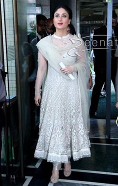 The royal beauty- Kareena Kapoor spotted very elegant in a white color anarkali suit made up of semi transparent net. Her anarkali suit had same color heavy embroidery all over. Transparent full sleeves and high neck pattern with a beautiful silver embellishment completed her royal look.