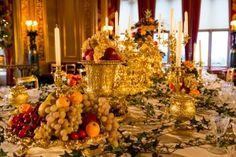 Windsor Castle State Dining Room, the table set with silver-gilt, including items from the Grand Service commissioned by George IV and still used by The Queen and her guests at State Banquets today.  Royal Collection Trust / © Her Majesty Queen Elizabeth II 2014 www.royalcollection.org.uk