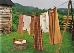 i like the idea of having a rustic clothesline out back-- the modern ones are such an eyesore
