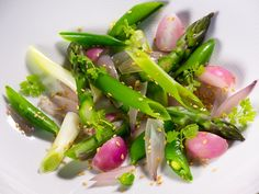 This recipe yields 4 servings.  Ingredients 8 radishes divided in 4 pieces 150 g sugar snaps sliced in half 5 scallions divided in 5 cm pieces 10 green asparagus divided in 5 cm pieces 5 shallots divided in 4 pieces and separated from individual layers Pan roasted sesame seeds * Chervil leaves 1 ss of your best olive oil Sea salt  Rinse all of the vegetables