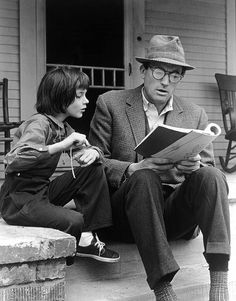 Gregory Peck and Mary Badham review the script for the 1962 film To Kill a Mockingbird on the movie set's front porch