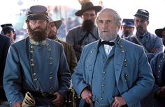 Full shot of Stephen Lang as Gen. Stonewall Jackson wearing Confederate uniform and hat/kepi, standing with Robert Duvall as Gen. Robert E. Lee, while other officers look on in background. Gods And Generals, Civil War Movies, Stephen Lang, Stonewall Jackson, Robert Duvall, War Film, Period Movies, Civil War Photos, About Time Movie