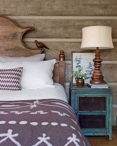Vacation homes shouldn't take themselves too seriously. The headboard in this cabin adds chirpy, nature-inspired charm to the cozy master bedroom.