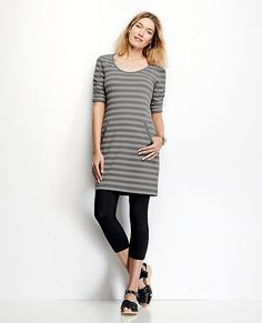 "Simple Scandinavian inspiration puts stripes everywhere you want to go in a supremely easy modern slipover. <br>• Cotton/spandex stretch jersey<br>• Scoop neck<br>• Shirred elbow sleeves<br>• Welt side pockets<br>• 35.5"" length<br>• Prewashed<br>• Imported $89"