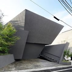 Black textured walls give this seemingly windowless Tokyo residence a bunker-like appearance. Read the full story on dezeen.com #architecture #japan