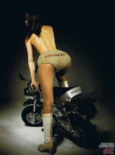 Girl on Honda bike