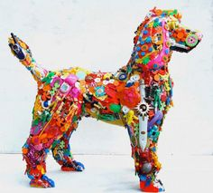 recycled art by Robert Bradford, Bradford, a former psychotherapist, is best known for creating sculptures from toy parts. He screws the toy parts onto a wooden armature to create his 3D sculptures.