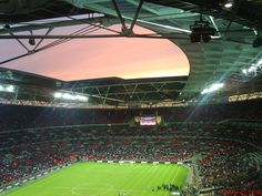 Sunset over Wembley Stadium, home to the English National Football team -- For today's healthy lifestyle, choose Old London. oldlondonfoods.com #wembley #london #soccer #football