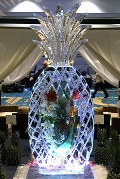 Single ice block, plus, with a pineapple and floral frozen into a pineapple ice sculpture for a local HS Prom. #icesculptures  #icesculpturesorlando
