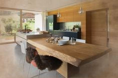 Tree Trunk Kitchen was designed by Willi Bruckbauer for Werkhaus by combining a solid oak tree trunk that has an unadulterated surface of . Kensington House, Extractor Hood, Oak Tree, Küchen Design, Solid Oak, Dining Table, Contemporary, The Originals