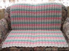 Follow this free crochet baby blanket pattern and learn how to crochet the cluster stitch. Finish the blanket off with a pretty crocheted edging.