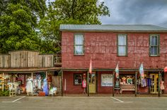 Bastrop Bling Company and Bluwr Miles in the Pine Street Village district of downtown Bastrop, Texas   via Flickr