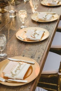 Gold chargers and rustic wood place setting -  see this wedding in it's entirety here! http://bit.ly/Hxl1Nb