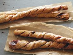 Cinnamon Bread Twists   Ingredients 1 cup 1-percent milk 4 tablespoons unsalted butter Two .25-ounce envelopes active dry yeast 1/2 cup raisins 2 1/4 cups white whole wheat flour 1 1/4 cups all-purpose flour, plus extra as needed 1 teaspoon kosher salt 2 large eggs 1/2 cup granulated sugar Nonstick cooking spray 2 tablespoons apple butter 2 tablespoons ground cinnamon 2 tablespoons packed dark brown sugar 1/4 cup confectioners' sugar