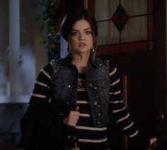 Aria in striped sweater with studded denim crop vest