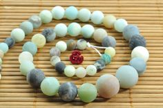 15 inches of Natural Amazonite matte round tower by YesBeads