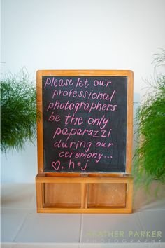 wedding ceremony sign for no guest photography made by a bride. It is a DIY project using a chalk board.