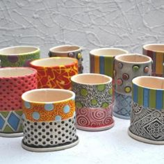 small, colorful, handbuilt, carved, stamped, painted and stained vessels