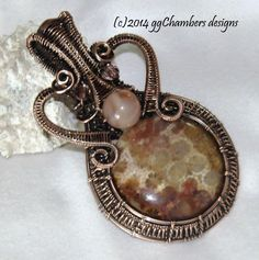 Indonesian Fossil Coral cabochon by Lexx Stones, accented with Botswana Agate bead. Natural copper wire, antiqued, hand rubbed, and sealed.