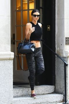 Miranda Kerr perfect the transitional gym-to-street wardrobe. Get the look on Vogue.com.