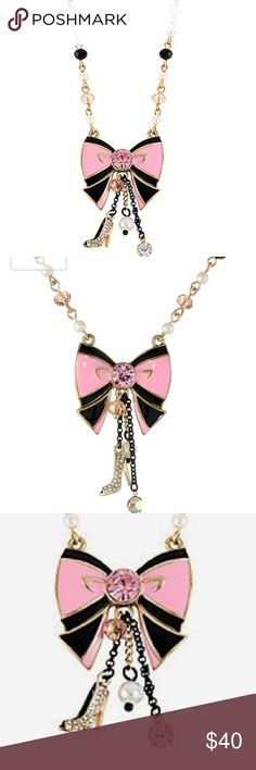 """NWT Betsey Johnson Bow W/ Charms Pendant Necklace """"Paris is Always a Good Idea"""" Bow Multi-Charm Pendant Necklace. Features: Items that are handmade may vary in size, shape and color Chain with cherry beads and faux pearls, pink and black bow pendant with crystal accent and gold tone details, black chains with faceted bead, faux pearl, crystal accent and shoe. Height2.25 inches Width1.25 inches Length19 inches Betsey Johnson Jewelry Necklaces"""