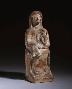 Demeter Enthroned holding Kore in her lap - circa 600-500 BCE, found Thebes - at the Louvre Museum