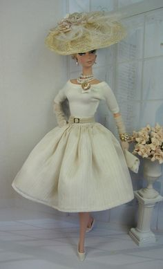 This romantic summery ensemble features a body suit cut from cream fine jersey knit with three-quarter length raglan sleeves, and button and loop back closure. An asymmetrical tab is accented with a antique mother of pearl button given to me by a wonderful fellow seamstress. The full skirt consists of three layers for maximum fullness, the first is a nude crinkle chiffon over a off white very fine raw woven silk,  a lining of cream china silk, waistband and button over snap back closure. A…