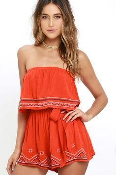 The perfect day can become an even better night in the Catch the Sunrise Coral Orange Strapless Embroidered Romper! Gauzy rayon falls from a strapless, elasticized neckline to a tier with cream and navy blue embroidery. Elastic waist has a tying sash belt above relaxed shorts.