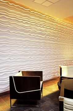 Modular Arts textured wall panels. Throw in some lighting for instantly awesome focal feature.