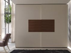 Ash wardrobe with sliding doors AGRIFOGLIO - Le Fablier