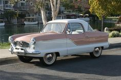 1957 NASH METROPOLITAN 2 DOOR COUPE:  My dad used to have one of these in turquoise and white.  I loved driving it!