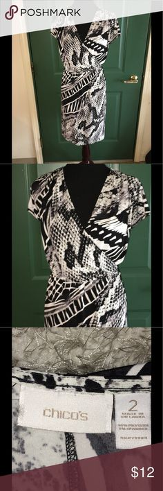 Chico's Faux Wrap Dress Size 12 Faux wrap style dress by Chico's.  Surplice bustline presents the faux wrap look.  Black and white print.  Chico's size 2, which converts to a misses 12.  See size chart photo.  Dress is 40 inches long.   Great condition.  Important:   All items are freshly laundered as applicable prior to shipping (new items and shoes excluded).  Not all my items are from pet/smoke free homes.  Price is reduced to reflect this!   Thank you for looking! Chico's Dresses