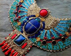 This listing is for a custom order; that means that I will create this necklace for you after you order it. Currently the earliest possible delivery for this necklace is 5 weeks from placing your order. Please message me for additional questions, and I will be happy to answer them. ***********    What a true special occasion statement jewelry piece! Inspired by a detail on Tutankhamuns ceremonial chair, this collar necklace is a reinvented classic that combines modern geometrical shapes and…