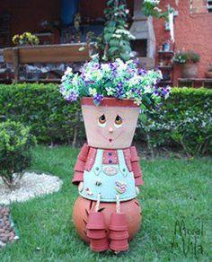 Boneca de vasos para o jardim