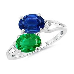 Enjoy the beauty of earth and heaven with this dramatically designed 14k white gold two-stone ring. The ring features a twisted split band holding an oval sapphire and an emerald in a bypass style with diamond accents for added brilliance. #twostonering #twostones #sapphireandemerald #emerald #bluesapphire #sapphirering #emeraldring #brilliance #ovalsapphire #whitegold #style #jewels #ring #voplus #voplusmagazine