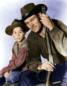Lft.-Johnny Crawford as Mark McCain,Rt.-Chuck Connors as Lucas McCain from the Rifleman.