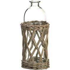 Tucked into a woven wicker caddy, this glass bottle is perfect for displaying a spray of bright berries or blooming roses.  Product:...