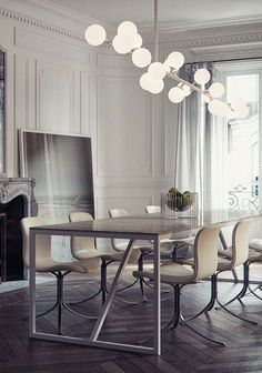 Poul Kjærholm PK9 dining chairs in leather, originally designed in 1961. lamp of bubbles