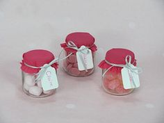 baby food jars used as place cards (name and table numbers) with hard-tack candies inside