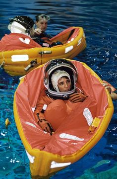 """""""Astronaut Nancy J. Currie, STS-109 mission specialist, floats in a small life raft during an emergency egress training session at the Neutral Buoyancy Laboratory (NBL) at the Sonny Carter Training Facility (SCTF) near the Johnson Space Center."""" I think it's just an added feminist bonus that her craft looks vaginal."""