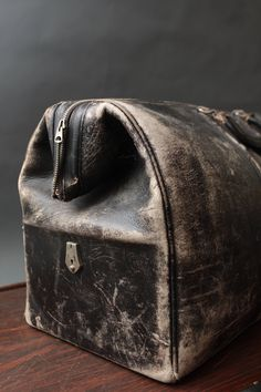 Vintage worn leather Elk Hide - Black Suitcase/Dr. Bag. $165.00, via Etsy.