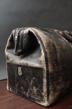 Vintage worn leather Elk Hide - Black Suitcase/Dr. Bag. $165.00, via Etsy.