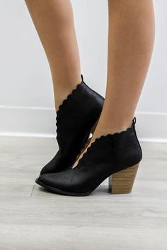 6a64fe9109ac Black booties have tulip detail and slip on fit New Fashion Trends