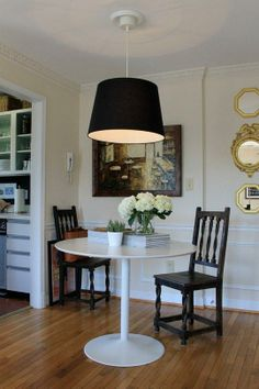 Kerra's Picture-Perfect Perch: pedestal lamp over  round dining table