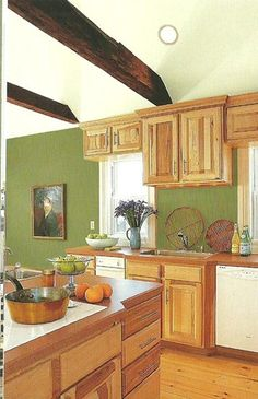 Paint Colors that go with WOOD {trim and cabinets} : : Use white to contrast, or same shade (green here) as wood color to blend.