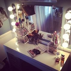 I really need a pretty, large vanity! I have sooo much makeup (seriously tote bags full!) and I want a really nice place to store it and keep it organized. Plus I would love to be able to sit down in a chair in front of a mirror while I apply it, especially because of (depending on how I'm doing my makeup) the length of time that it takes me to do my makeup and hair!