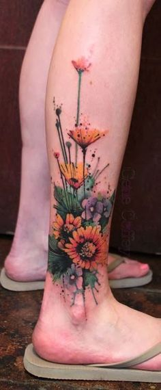 Fantastic ankle flower tattoo. Click to discover more Sensational Flower Tattoos.