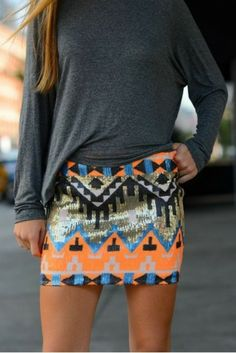 Loving how our neon orange skirt instantly adds a pop of color. Get it now at ICIFashion.com