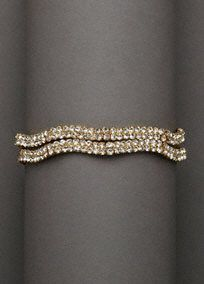 "This double row rhinestone wave bracelet adds a simple sparkle to any look.  Features double row, adorned with beautiful crystal rhinestones.  Bracelet measures 7 1/2"".  Imported."