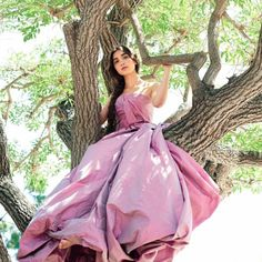 Row in a ball gown in a tree. Only she can pull this off...